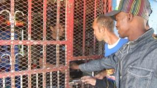 Customers at one of South Africa's spaza small shops