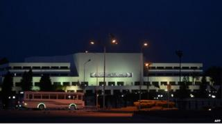 A bus is driven past the Pakistan parliament building in Islamabad in the dark on 29 April 2014