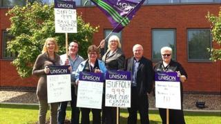 Unison members protesting at the plans for a control room merger outside Norfolk Police HQ