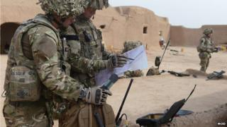 Soldiers in Afghanistan using communications equipment