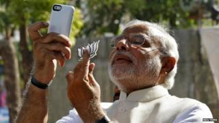 Mr Modi cast his vote in Ahmedabad