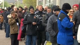 Fans queuing