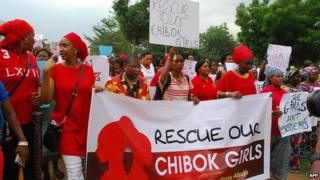 "Former Nigerian Education Minister and Vice-President of the World Bank""s Africa division (3r L) Obiageli leads a march of Nigeria women and mothers of the kidnapped girls of Chibok, calling for their freedom in Abuja on April 30, 2014."