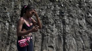 Woman cries at collapsed mine in Colombia
