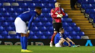 Birmingham City players look frustrated after defeat against Wigan