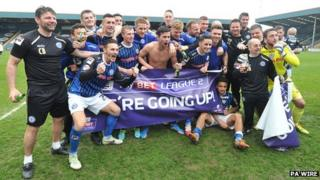 Rochdale players celebrate promotion to League One during the Sky Bet League Two match at Spotland, Rochdale