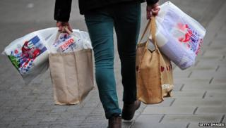 Man with Tesco shopping bags