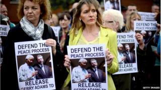 """People holding """"release Gerry Adams"""" posters"""