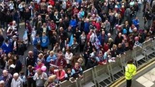 Burnley fans wait for the players to arrive outside the Burnley Town Hall
