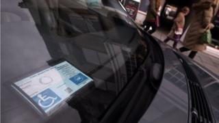 Blue badge in car window