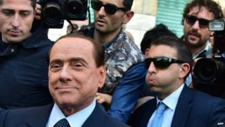 Silvio Berlusconi leaves the Milan's justice office (23 April 2014)