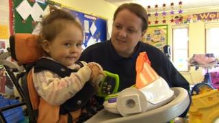 Gabby, two, with carer
