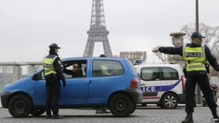 Police stopping a car in Paris - file pic