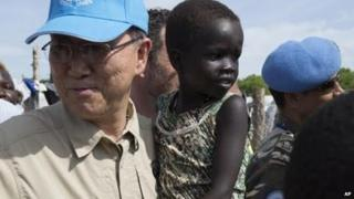United Nation Secretary-General, Ban Ki-moon holds a child in a UN camp in Juba South Sudan, Tuesday 6 May 2014