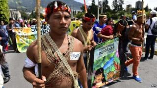 Huaorani natives and Yasunidos ecologist group activists march in Quito on April 12, 2014.