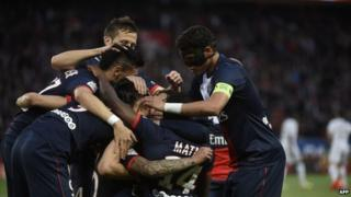 Paris Saint-Germain's players celebrate after scoring against Rennes at the Parc Des Princes stadium in Paris on 7 May 2014