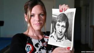 Adele Greenacre holding up a picture of her father Derek aged 33