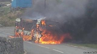 The bus in flames