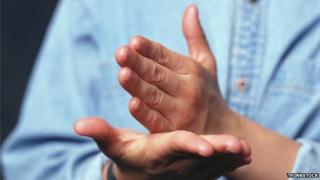 Someone using sign language