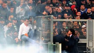 Ultra fan Gennaro De Tommaso speaks to football officials at the Coppa Italia final on 3 May