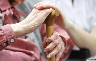Elderly woman and young woman's hands
