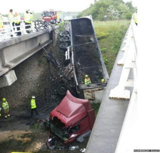 Lorry fallen off bridge