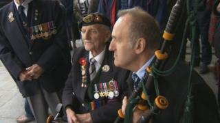 D-Day pipes with veteran soldiers