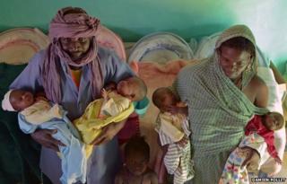 Parents holding their quadruplets