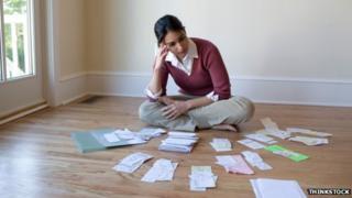 woman examines bills
