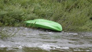Kayak on riverbank