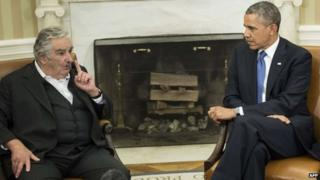 President Obama (R) listens while Uruguay President Jose Mujica speaks to the press in Washington, DC, on May 12, 2014.