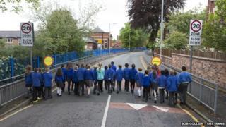 Children walking along road