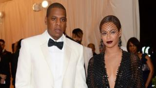 Jay Z and Beyonce walk the red carpet before a 5 May, 2014, gala at the Metropolitan Museum of Art in New York.