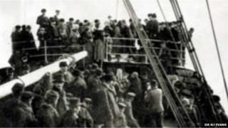 Migrants onboard a ship