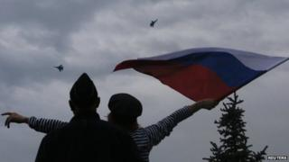 Woman waving a Russian flag