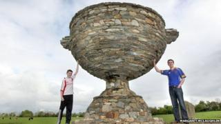 Antony Barrettes' sons Peter and Anthony jnr with the Sam Maguire made from stone