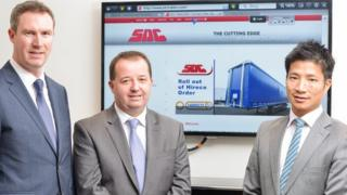 SDC Vice Chairman Darren Donnelly and Managing Director Mark Cuskeran with Tony Wan of Hireco