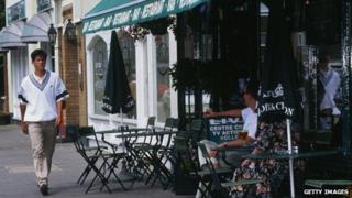 Tim Henman walks along Wimbledon high street
