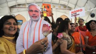 An Indian woman holds a picture of opposition leader Narendra Modi