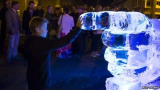 Boy with Ice sculpture