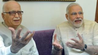 Indian prime-minister elect Narendra Modi (R) and Bharatiya Janata Party (BJP) senior leader Lal Krishna Advani gesture to the press at Gujarat bhawan in New Delhi on May 18, 2014. Prime
