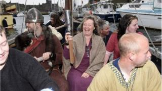 The baton was carried across Peel harbour on a Viking longboat on Sunday