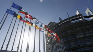 Flags outside European Parliament building in Strasbourg