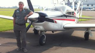 Dave McElroy and plane