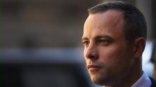 Oscar Pistorius leaves North Gauteng High Court after the judge ordered that he should undergo mental evaluation on May 14, 2014 in Pretoria, South Africa.