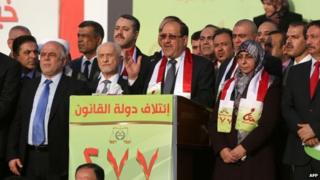 Nouri Maliki attends a State of Law election rally in Baghdad on 26 April 2014