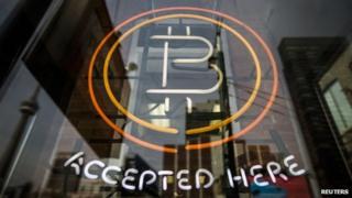 Bitcoin logo in shop window