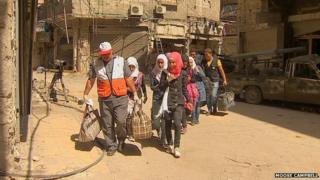 Students being allowed out of Yarmouk