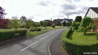 Police were called to Millfield Drive, Market Drayton, at around 08:20 BST.