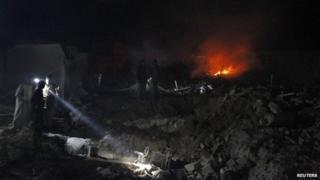 Aftermath of what activists said was a missile attack in northern Syrian town of Marea (20 May 2014)